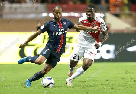 PSG player Moura Lucas, left, challenges for the ball with Monaco player Elderson Uwa Echiejile during their French League One soccer match, in Monaco stadium