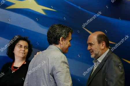 Euclid Tsakalotos, Nadia Valavani, Tryfon Alexiadis Greece's Finance Minister Euclid Tsakalotos, center, is greeted by outgoing Alternate Finance Minister Nadia Valavani, left, and the incoming Tryfon Alexiadis during the hand over ceremony in Athens, . Greek banks finally reopened after three weeks of being closed but new austerity taxes meant that most everything was more expensive - from coffee to taxis to cooking oil