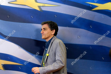 Stock Image of Euclid Tsakalotos Greece's Finance Minister Euclid Tsakalotos arrives for the handover ceremony of the outgoing Alternate Finance Minister Nadia Valavani and the incoming Tryfon Alexiadis in Athens, . Greek banks finally reopened after three weeks of being closed but new austerity taxes meant that most everything was more expensive - from coffee to taxis to cooking oil