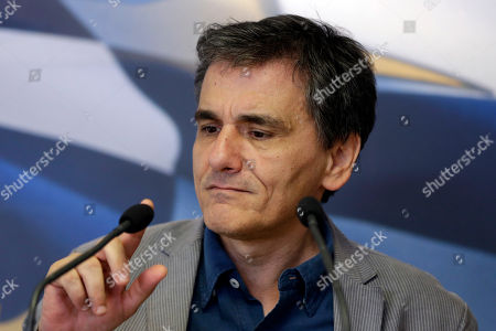 Stock Photo of Euclid Tsakalotos Greece's Finance Minister Euclid Tsakalotos checks the microphone before his speech during the handover ceremony of the outgoing Alternate Finance Minister Nadia Valavani and the incoming Tryfon Alexiadis in Athens, . Greek banks finally reopened after three weeks of being closed but new austerity taxes meant that most everything was more expensive - from coffee to taxis to cooking oil