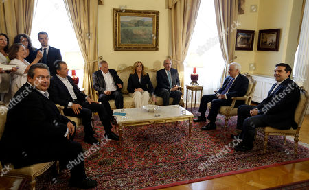 Panos Kammenos, Stavros Theodorakis, Thanassis Pafilis, Fofi Gennimata, Vangelis Meimarakis, Prokopis Pavlopoulos, Alexis Tsipras From left to right, Greek Defense Minister Panos Kammenos, who heads the government's junior coalition member Independent Greeks, leader of Potami party Stavros Theodorakis, lawmaker of the Greek Communist Party Thanassis Pafilis, PASOK Socialist party leader Fofi Gennimata, New Democracy leader Vangelis Meimarakis, Greek President Prokopis Pavlopoulos and Prime Minister Alexis Tsipras attend a meeting ahead of a meal to mark the 41st anniversary of the country's return to democracy after the 1974 fall of the junta then ruling Greece, at the presidential palace in Athens, . High-level talks between Greece and its European creditors on a third bailout for the cash-strapped country have been delayed until logistical matters are sorted out