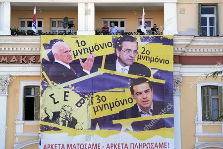Members of the Communist-affiliated PAME labor union hang an anti-austerity banner depicting and reading ''1st memorandum with former Greek Prime Minister George Papandreou, 2nd memorandum with former Prime Minister Antonis Samaras, 3rd memorandum with Greek Prime Minister Alexis Tsipras. We bleed enough, we paid enough'' during a protest at the Ministry of Macedonia and Thrace in the northern Greek port city of Thessaloniki, . Talks on a bailout worth 85 billion euros ($94 billion) will start if Parliament agrees by Wednesday to creditors' demands, including painful tax hikes and pension cuts