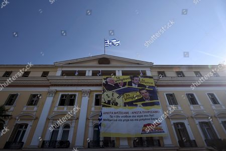 Members of the Communist-affiliated PAME labor union hang an anti-austerity banner depicting and reading ''1st memorandum with former Greek Prime Minister George Papandreou, 2nd memorandum with former Prime Minister Antonis Samaras, 3rd memorandum with Greek Prime Minister Alexis Tsipras. We bled enough, we paid enough'' during a protest at the Ministry of Macedonia and Thrace in the northern Greek port city of Thessaloniki, . Talks on a bailout worth 85 billion euros ($94 billion) will start if Parliament agrees by Wednesday to creditors' demands, including painful tax hikes and pension cuts