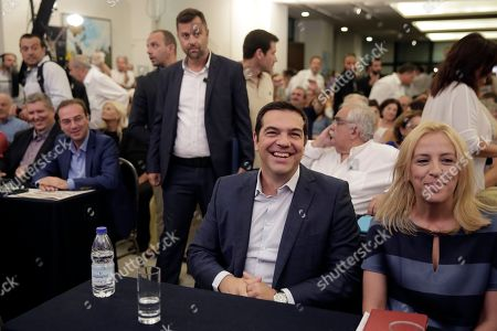 Stock Picture of Alexis Tsipras, Rena Dourou Outgoing Greek Prime Minister and the Syriza party leader Alexis Tsipras, second right, sits next to Regional Government of Attica Rena Dourou at a gathering of his party members in Athens, on . Tsipras is banking on his popularity to win a national election next month and strengthen his grip on power after purging his radical left Syriza party of dissenters