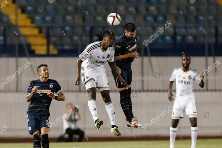 AIK's Dickson Etuhu, second left, jumps for the ball against Atromitos' Sokratis Fitanidis during their Europa League third qualifying round second leg match in Athens