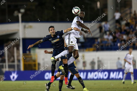 Atromitos' Fernando Usero, left, jumps for the ball with AIK's Dickson Etuhu, during the Europa League third qualifying round second leg match between Atromitos FC and AIK Fotboll in Athens