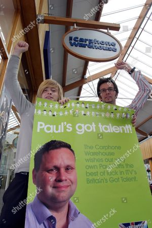 Stock Photo of Staff from the Carphone Warehouse store in Macarthur Glen outlet centre, Bridgend, South Wales, celebrate Paul Potts' victory. Daniel Phillips (left) and Chris Norton (right) are both colleagues of Paul Potts