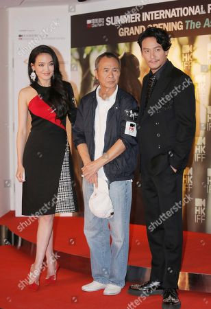 """Shu Qi, Hou Hsiao-hsien, Chang Chen Taiwanese actress Shu Qi, left, director Hou Hsiao-hsien, center, and actor Chang Chen pose at the opening of the Cine Fan Summer Film Festival and the premiere of their movie """"The Assassin"""" in Hong Kong"""