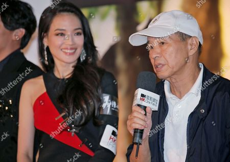 """Shu Qi, Hou Hsiao-hsien Taiwanese actress Shu Qi, left, smiles as director Hou Hsiao-hsien speaks during the opening of the Cine Fan Summer Film Festival and the premiere of their movie """"The Assassin"""" in Hong Kong"""