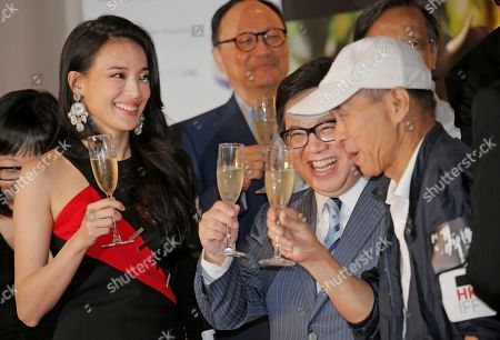 """Shu Qi, Hou Hsiao-hsien, Wilfred Wong Taiwanese actress Shu Qi, left, director Hou Hsiao-hsien, right, and Wilfred Wong, center, chairman of the Hong Kong International Film Festival Society, toast at the opening of the Cine Fan Summer Film Festival and the premiere of Shu and Hou's movie """"The Assassin"""" in Hong Kong"""