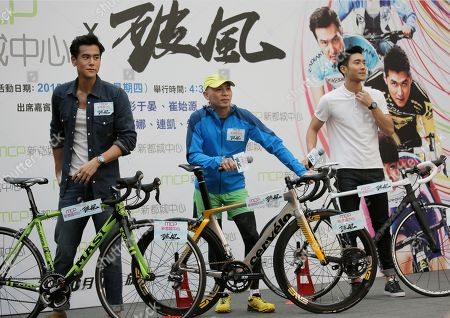 Stock Picture of Lam Chiu Yin, Eddie Peng, Choi Siwon Taiwanese actor Eddie Peng, left, Hong Kong director Lam Chiu Yin, center, and Choi Siwon, a member of South Korean pop group Super Junior, pose for photographers during a promotional event of their new movie To The Fore in Hong Kong