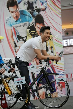 Stock Image of Choi Siwon Choi Siwon, a member of South Korean pop group Super Junior, poses for photographers during a promotional event of his new movie To The Fore in Hong Kong