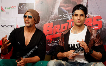 """Akshay Kumar, Sidharth Malhotra Indian Bollywood actors Akshay Kumar, left, and Sidharth Malhotra attend a press conference of their upcoming movie """"Brothers"""" in Ahmadabad, India, . The film is scheduled to release on Aug. 14"""