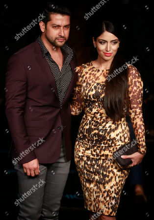 Aftab Shivdasani, Nin Dusanj Indian Bollywood actor Aftab Shivdasani, left, along with his wife Nin Dusanj pose for photographs during the Lakme Fashion Week in Mumbai, India