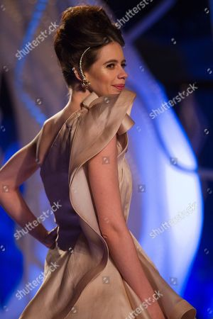 An Indian bollywood actor Kalki Koechlin displays a creation by Indian designer Gaurav Gupta at the Amazon India Couture Week 2015 in New Delhi, India
