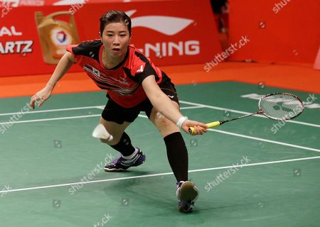 Korea's Bae Yeon Ju prepares to make a forehand return to Bulgaria's Linda Zetchiri during their women's singles match at the Badminton World Federation championships at Istora Stadium in Jakarta, Indonesia