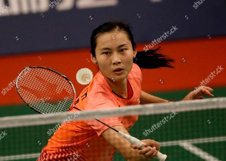 China's Wang Yihan makes a backhand return to South Korea's Bae Yeon Ju during their women's singles match at the Badminton World Federation championships at Istora Stadium in Jakarta, Indonesia