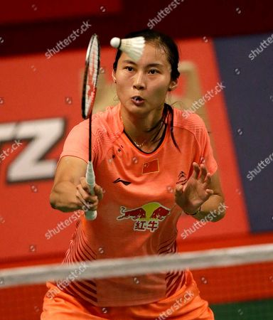 China's Wang Yihan makes a forehand return to South Korea's Bae Yeon-ju during their women's singles match at the Badminton World Federation championships at Istora Stadium in Jakarta, Indonesia
