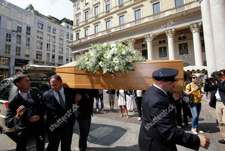 Stock Photo of Pallbearers carry the casket of Italian fashion designer Elio Fiorucci during the funeral service in Milan, Italy