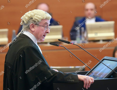"""Senior Adviser of the Italian delegation Sir Michael Wood speaks during the first public hearing on the request for provisional measures in the """"Enrica Lexie"""" incident at the International Tribunal for the Law of the Sea in Hamburg, northern Germany, . The tribunal is hearing a call from Italy to order that India put on hold its case against two Italian marines pending arbitration of a dispute over a 2012 incident in which they are accused of killing two Indian fishermen"""