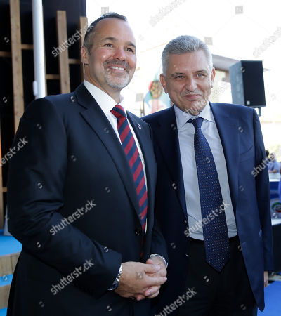 Stock Picture of Bologna president Joe Saputo, left, is flanked by Frosinone president Maurizio Stirpe as they attend the draws for the upcoming Italian soccer Serie A championship in Rho, near Milan, Italy, Monday, July 27, 2015