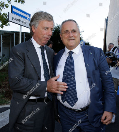 Lazio's president Claudio Lotito, right, is flanked by Genoa's Enrico Preziosi attend the draws for the upcoming Italian soccer Serie A championship in Rho, near Milan, Italy, Monday, July 27, 2015