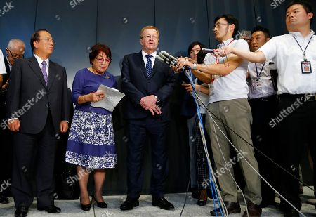 John Coates International Olympic Committee Vice President John Coates, center, answers reporter's questions during a press conference after meeting with Japan's Olympics Minister Toshiaki Endo in Tokyo, . The top International Olympic Committee official has urged Japan to speed up the troubled construction of Tokyo's new national stadium for delivery by January 2020