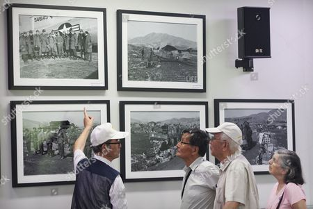 "Kim Myeong Bok, Kang Hi-dong, Maria Kang In this . Kim Lee-nam, left, a South Korean war veteran of the Korean War, speaks about photos of Chipyong-ri Battle to Kim Myeong Bok, second from left, and Kang Hi-dong, second from right, former North Korean prisoners of war held in South Korea during the 1950-53 war, at Chipyong-ri Battle Memorial Hall in Yangpyeong, South Korea. Kim and Kang, living in San Francisco, came back to South Korea on July 23 with a South Korean movie director who's making a documentary on ex-POWs. The film, titled ""Return Home,"" is intended to trace back their turbulent lives, but the men may not be able to make one important stop. Pyongyang has not given them permission to enter North Korea. At right is Maria Kang, wife of Kang"