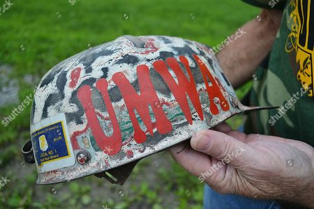 Kenny Johnson holds a coal miner's hardhat in Harlan County, Ky., on . Johnson was given the hat by another union miner and Johnson used it until his retirement. Kentucky is now without a single union mine in the entire state after the closing of the Patriot Coal-owned Highland mine in December 2014