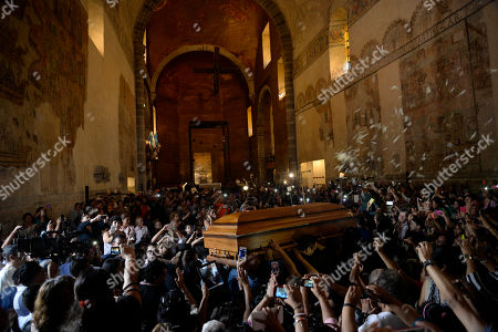 """The coffin containing the remains of Mexican ballad singer Joan Sebastian is carried into the cathedral in Cuernavaca, Mexico, . The Grammy and Latin Grammy award winner died Monday. He was best known for sentimental love songs such as, """"Tatuajes"""" and """"Secreto de Amor."""" He was 64"""