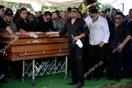 Stock Picture of Joan Sebastian Friends and relatives of Mexican ballad singer Joan Sebastian gather around his coffin at the cemetery in Juliantla, Mexico, . Sebastian, one of Mexico's great ballad singers, died on July 13. He was 64. After five days of homage and farewells by thousands of fans, Sebastian was laid to rest in his hometown's cemetery