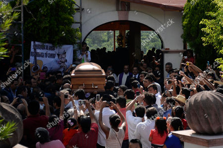 Joan Sebastian Hundreds of people gather around the entrance to the Virgin of the Rosary church as the coffin containing the remains of Mexican ballad singer Joan Sebastian arrives in Juliantla, Mexico, . Sebastian, one of Mexico's great ballad singers, died on July 13. He was 64. After five days of homage and farewells by thousands of fans, Sebastian was laid to rest in his hometown's cemetery