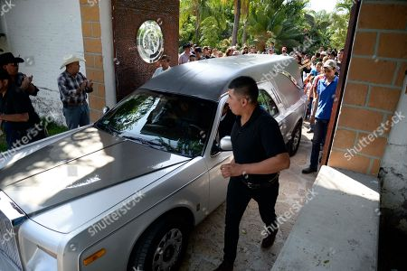 """The hearse transporting the coffin containing the remains of Mexican ballad singer Joan Sebastian leaves his home in Teacalco, Mexico, . The Grammy and Latin Grammy award winner died Monday. He was best known for sentimental love songs such as, """"Tatuajes"""" and """"Secreto de Amor."""" He was 64"""