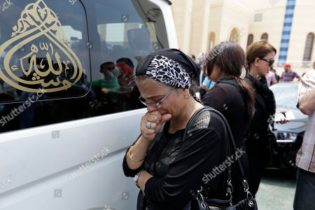 """A woman mourns next to a car carrying the coffin of Egyptian actor Omar Sharif during his funeral procession at the Hussein Tantawi Mosque in Cairo, Egypt, . Sharif, the Egyptian-born actor with the dark, soulful eyes who soared to international stardom in movie epics, """"Lawrence of Arabia"""" and """"Doctor Zhivago,"""" died in a Cairo hospital of a heart attack, on Friday, July 10. He was 83"""