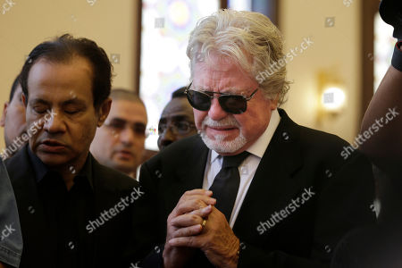 """Hussein Fahmy Egyptian actor Hussein Fahmy, right, mourns next to the coffin of Egyptian actor Omar Sharif during his funeral procession at the Hussein Tantawi Mosque in Cairo, Egypt, . Sharif, the Egyptian-born actor with the dark, soulful eyes who soared to international stardom in movie epics, """"Lawrence of Arabia"""" and """"Doctor Zhivago,"""" died in a Cairo hospital of a heart attack, on Friday, July 10. He was 83"""