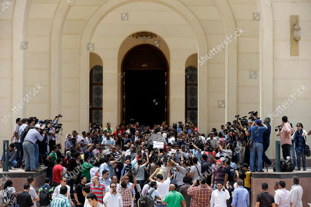 """Mourners carry the coffin of Egyptian actor Omar Sharif during his funeral procession at the Hussein Tantawi Mosque in Cairo, Egypt, . Sharif, the Egyptian-born actor with the dark, soulful eyes who soared to international stardom in movie epics, """"Lawrence of Arabia"""" and """"Doctor Zhivago,"""" died in a Cairo hospital of a heart attack, on Friday, July 10. He was 83"""