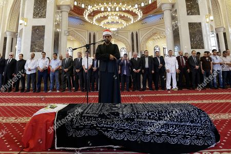 """Mourners pray over the coffin of Egyptian actor Omar Sharif during his funeral procession at the Hussein Tantawi Mosque in Cairo, Egypt, . Sharif, the Egyptian-born actor with the dark, soulful eyes who soared to international stardom in movie epics, """"Lawrence of Arabia"""" and """"Doctor Zhivago,"""" died in a Cairo hospital of a heart attack, on Friday, July 10. He was 83"""