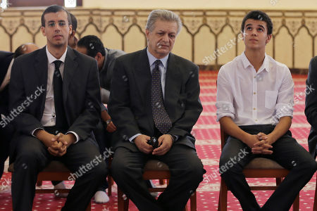 """Tarek El-Sharif Tarek El-Sharif, center, with his children attends the funeral of his father Egyptian actor Omar Sharif at the Hussein Tantawi Mosque in Cairo, Egypt, . Sharif, the Egyptian-born actor with the dark, soulful eyes who soared to international stardom in movie epics, """"Lawrence of Arabia"""" and """"Doctor Zhivago,"""" died in a Cairo hospital of a heart attack, on Friday, July 10. He was 83"""
