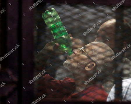 Mohammed Badie Muslim Brotherhood spiritual leader Mohammed Badie, wearing a red jumpsuit that designates he has been sentenced to death, drinks at the defendants cage in a makeshift courtroom at the Torah prison, Southern Cairo, Egypt