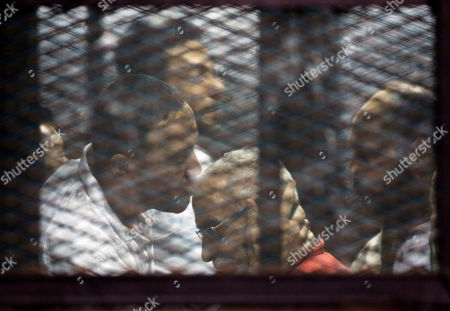 Mohammed Badie Muslim Brotherhood spiritual leader Mohammed Badie, wearing a red jumpsuit that designates he has been sentenced to death, is greeted by other group members at the defendants cage in a makeshift courtroom at the Torah prison, southern Cairo, Egypt