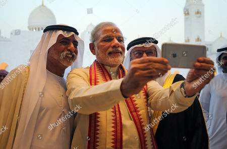 Narendra Modi, Sheikh Hamdan bin Mubarak Al Nahyan Indian Prime Minister Narendra Modi, middle, takes a selfie next to Sheikh Hamdan bin Mubarak Al Nahyan, UAE Minister of Higher Education and Scientific Research, left, as they tour the Sheikh Zayed Grand Mosque during the first day of his two-day visit to the UAE, in Abu Dhabi, United Arab Emirates, . The UAE is home to over two million Indian expatriates and this is the first visit by an Indian premier in over three decades