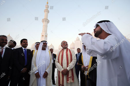 Narendra Modi, Hamdan bin Mubarak Al Nahyan Indian Prime Minister Narendra Modi, center, listens to a guide as he visits the Sheikh Zayed Grand Mosque with Sheikh Hamdan bin Mubarak Al Nahyan, UAE Minister of Higher Education and Scientific Research, second left, during the first day of a two-day visit to the UAE, in Abu Dhabi, United Arab Emirates, . The UAE is home to over two million Indian expatriates and this is the first visit by an Indian premier in over three decades