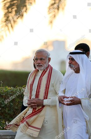 Narendra Modi, Hamdan bin Mubarak Al Nahyan Indian Prime Minister Narendra Modi, left, walks with Sheikh Hamdan bin Mubarak Al Nahyan, UAE Minister of Higher Education and Scientific Research, during a visit to the Sheikh Zayed Grand Mosque during the first day of a two-day visit to the UAE, in Abu Dhabi, United Arab Emirates, . The UAE is home to over two million Indian expatriates and this is the first visit by an Indian premier in over three decades