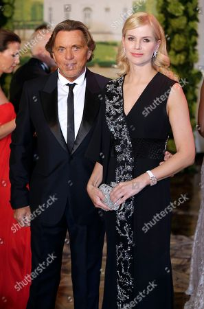 """German designer Otto Kern and his wife Naomi Valeska arrive at the """"Monaco Red Cross Ball"""", in Monaco. The Monaco Red Cross Ball is a charity gala evening bringing together high society as well as donors from all over the world"""