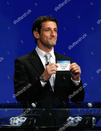 Juliano Belletti Former Brazilian player Juliano Belletti shows the name of Athletico de Madrid, who will play in Group C, during the UEFA Champions League draw at the Grimaldi Forum, in Monaco