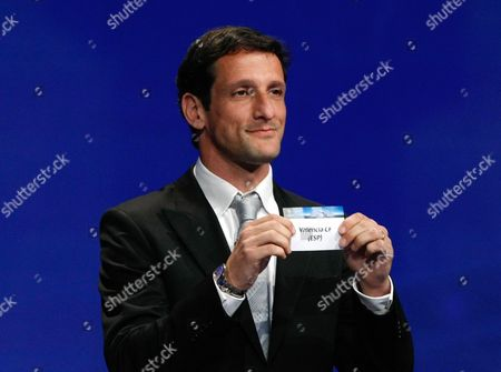 Juliano Belletti Former Brazilian player Juliano Belletti shows the name of Valencia, who will play in Group H, during the UEFA Champions League draw at the Grimaldi Forum, in Monaco