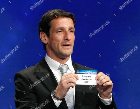 Stock Photo of Juliano Belletti Former Brazilian player Juliano Belletti shows the name of Bayer 04 Leverkusen, who will play in Group E, during the UEFA Champions League draw at the Grimaldi Forum, in Monaco