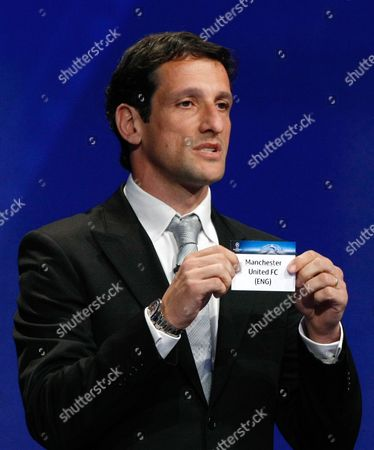 Juliano Belletti Former Brazilian player Juliano Belletti shows the name of Manchester United, who will play in Group B, during the UEFA Champions League draw at the Grimaldi Forum, in Monaco