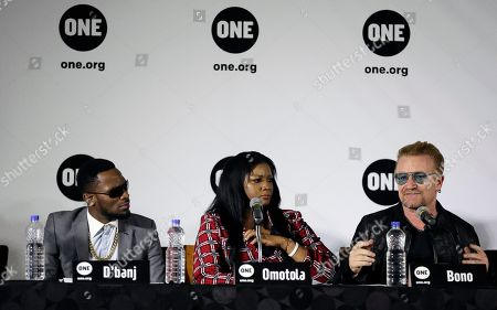 """Stock Photo of Irish rock star Bono, right, speaks during a press conference with Nollywood actress Omotola Jalade Ekeinde, center, and Nigeria artist D'banj in Lagos, Nigeria, African stars and rock star Bono say music can help push for the empowerment of women globally. Bono and the top African male musicians D'banj, Diamond and Banky W announced Friday that they will be included in a remix of the song """"Strong Girl"""" - a rallying cry for women's empowerment which features top African female talent"""