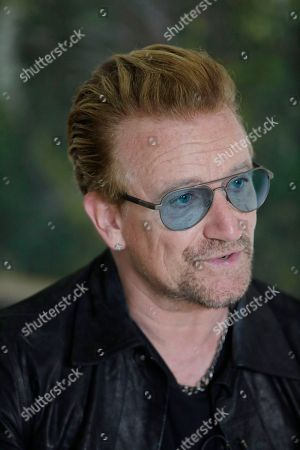 """Stock Picture of Irish rock star Bono speaks during an interview with the Associated Press in Lagos, Nigeria, African stars and rock star Bono say music can help push for the empowerment of women globally. Bono and the top African male musicians D'banj, Diamond and Banky W announced Friday that they will be included in a remix of the song """"Strong Girl"""" - a rallying cry for women's empowerment which features top African female talent"""